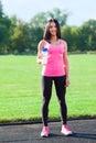 Woman drink water bottle sport on stadium Royalty Free Stock Photo