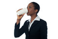 Woman drinking beverage corporate enjoying her Stock Image