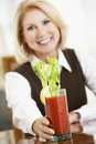 Woman Drinking A Bloody Mary Stock Image