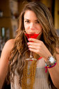 Woman drinking a cocktail beautiful red at the club Stock Images