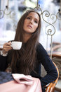 Woman drinking coffee in coffe shop Royalty Free Stock Photo