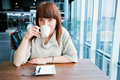 Woman drinking coffee corporate restaurant looking camera Royalty Free Stock Images