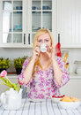 Woman drinking coffee at home Royalty Free Stock Photography