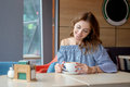 Woman drinking coffee in the morning at restaurant Royalty Free Stock Photo