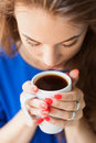 Woman drinking coffee in photo with very soft focus Royalty Free Stock Photo