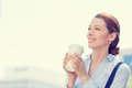Woman drinking coffee in sun standing outdoor Royalty Free Stock Photo