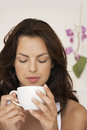 Woman drinking cup of coffee at home beautiful young Royalty Free Stock Photo