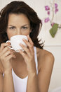 Woman drinking cup of coffee at home closeup portrait beautiful young Stock Images