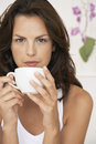 Woman drinking cup of coffee at home portrait beautiful young Stock Photo