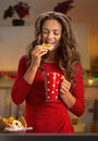 Woman drinking cup of hot chocolate with cookies young christmas Royalty Free Stock Photography