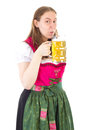 Woman drinking delicious beer at oktoberfest in dirndl Stock Photo