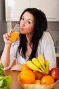 Woman drinking fresh orange juice Royalty Free Stock Photo