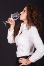 Woman drinking a glass of water Stock Image