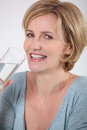 Woman drinking a glass of water Royalty Free Stock Image