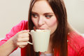 Woman drinking hot coffee beverage caffeine cup of young girl with energizing that keeps her awake energy and Stock Image