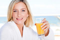 Woman drinking juice Royalty Free Stock Images