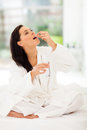 Woman drinking medicine beautiful at home Stock Photo