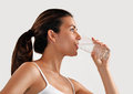Woman drinking mineral water Royalty Free Stock Photo