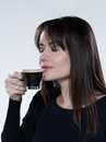 Woman drinking smelling coffee Stock Photography