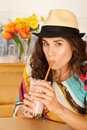 Woman Drinking a Smoothie Royalty Free Stock Images