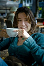 Woman drinking tea / coffee Stock Photo