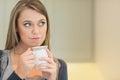 Thoughtful woman drinking coffee
