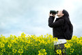 Woman drinking from water bottle in field Royalty Free Stock Photo