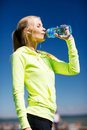 Woman Drinking Water After Doi...