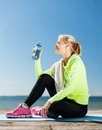 Woman drinking water after doing sports outdoors sport and lifestyle concept Royalty Free Stock Photography