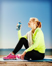 Woman drinking water after doing sports outdoors sport and lifestyle concept Royalty Free Stock Images