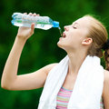 Woman drinking water after exercise Stock Photos