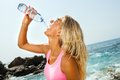 Woman drinking water after fitness workout. Stock Photo