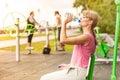 Woman with drinking water taking break. Fitness.