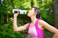 Woman Drinking Water after a Workout Outdoors Royalty Free Stock Photo