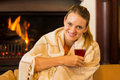 Woman drinking wine smiling young sitting alone and red at home Stock Image
