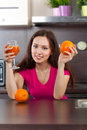 Woman drinks fresh juice young at domestic cooking Royalty Free Stock Image