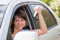 Woman driver after the helm of car with the keys Stock Photo