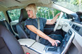 Woman driver parking her car attractive blond looking back and Royalty Free Stock Photography