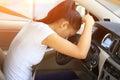 Woman driver sad in car