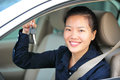 Woman driver show car keys asian happy with her new Royalty Free Stock Photo