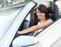 Woman driving a car beautiful convertible looking very happy Royalty Free Stock Image