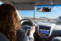 Woman driving car on highway, inside view Royalty Free Stock Photo