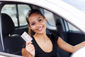 Woman driving licence cheerful young showing a she just got Royalty Free Stock Photography