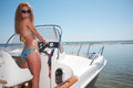 Woman driving a motor boat beautiful Stock Photos