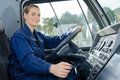 Woman in driving seat heavy goods vehicle