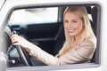 Woman driving smiling blonde women her car Stock Images