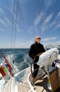 Woman driving yacht Stock Images