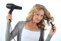 Woman drying hair Stock Photos
