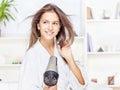Woman drying hair at home Stock Image