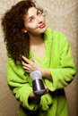 Woman drying her hair with hairdryer Stock Photography